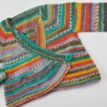 Cross over cardigan. 6-9 months. £15. 100% wool. Machine washable at 30C. bizubebeknits@gmail.com